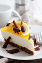 Lemon cheesecake with slice and chocolate curls Stock Photos