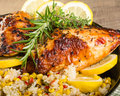 Lemon chicken with rice and roasted corn Royalty Free Stock Photo