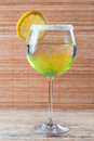 Lemon cocktail in a glass on wooden background Royalty Free Stock Image