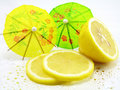 Lemon and cocktail umbrellas Stock Image