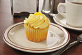 Lemon cupcake and coffee a cup cake served in a diner Royalty Free Stock Images