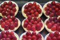 Lemon custard fruit tarts with raspberries curd at bakery shop Royalty Free Stock Images