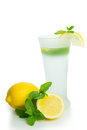Lemon drink with lemons and mints isolated on white background Royalty Free Stock Images