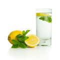 Lemon drink with lemons and mints on white background Stock Photo