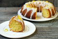 Lemon drizzle bundt cake on plate Stock Photos