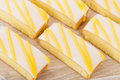 Lemon drizzle cake slices of topped with icing Royalty Free Stock Image