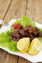 Lemon with grilled meat juicy and salad Stock Images