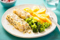 Lemon herb thyme seasoned chargrills with broccoli and potato chips Royalty Free Stock Photo