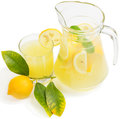 Lemon juice with lemon fruit glass and jug leaves on white Royalty Free Stock Images