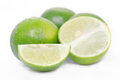 Lemon or lime fruit with half cross section and partial section also known as in french citrus green key persian kaffir desert Royalty Free Stock Photography