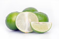 Lemon or lime fruit with half cross section and partial section other names are in french citrus green key persian kaffir desert Stock Photography