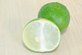 Lemon or lime fruit with half cross section and partial section other names are in french citrus green key persian kaffir desert Stock Image