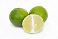 Lemon or lime fruit with half cross section and partial section x other names are in french citrus green key persian kaffir desert Royalty Free Stock Photos