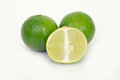 Lemon or lime fruit with half cross section on white other names are in french citrus green key persian kaffir desert Royalty Free Stock Photos
