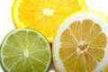 A Lemon, Lime and an orange cut Royalty Free Stock Photo
