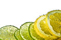 Lemon and lime slices in water Royalty Free Stock Photo