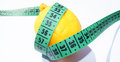 Lemon and measuring tape Stock Photography