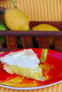 Lemon Meringue Pie on Red Plate Stock Photo