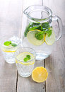 Lemon and mint fizz in jar glasses Royalty Free Stock Image