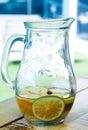 Lemon and orange in jar glasses Royalty Free Stock Photo