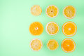 Lemon and orange slices on the  light blue background top view Royalty Free Stock Photo