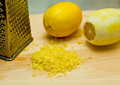 Lemon peel lemons and on wooden board with grater Stock Images