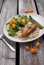 Lemon Pepper Chicken with Rice on weathered wood Royalty Free Stock Photo
