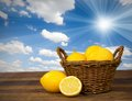 Lemon photo of in a basket on wooden desk with sky Stock Photo