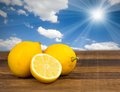 Lemon photo of on wooden desk with sky Royalty Free Stock Images