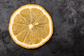 Lemon piece of on metal curved surface Royalty Free Stock Images