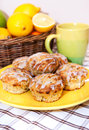 Lemon poppy seed muffins plate of fresh with icing Royalty Free Stock Image