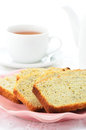 Lemon poppyseed loaf slices with cup of tea in vertical format Stock Images