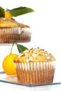 Lemon poppyseed muffin a with slivered almonds on top on square glass plate with and additional muffins on glass tray Stock Photo