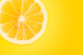Lemon portion on yellow background Royalty Free Stock Photo