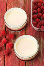 Lemon possets with raspberries Stock Photo