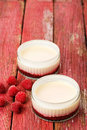 Lemon possets with raspberries Stock Photography