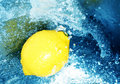 Lemon in rushing water Stock Photography