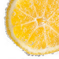 Lemon slice with bubbles Royalty Free Stock Photo