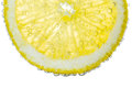 Lemon slice in clear fizzy water bubble background isolated Royalty Free Stock Photography