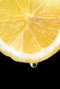 Lemon slice details of a fresh juicy black background Stock Images
