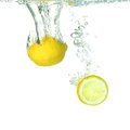 Lemon and a slice lemon falling in water Royalty Free Stock Images