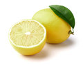 Lemon with slice on a white background Stock Images