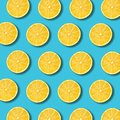 Lemon slices pattern on vibrant turquoise color background Royalty Free Stock Photo