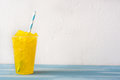Lemon slushie on blue wood Royalty Free Stock Photo