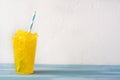 Lemon slushie on blue wood Royalty Free Stock Photo