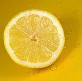 Lemon stock image a detailed on a yellow background Royalty Free Stock Photography