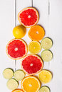 Lemon, tangerine, orange and pink grapefruit on white wood Royalty Free Stock Photo