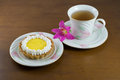 Lemon tart with a cup of tea on a wooden background Stock Photos