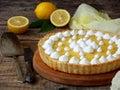 Lemon tart pie with meringue cream. Homemade cake on wooden background. Horizontal photo Royalty Free Stock Photo