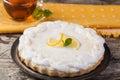 Lemon tart on a plate decorated with lemons Stock Photos